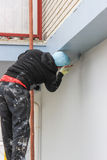 Worker painting facade Stock Photography