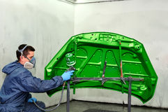 Worker painting green. Royalty Free Stock Photography