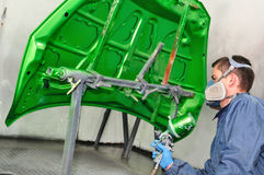 Worker painting green. Stock Photos