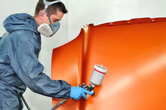 Worker painting green. stock image