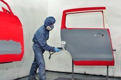 Worker painting car door. Stock Photography