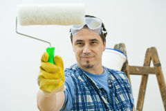 Worker painting with roller. Isolated on white background stock photos