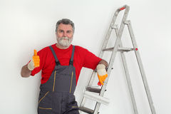 Worker painting  room to white Stock Image