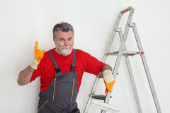 Worker painting  room to white Royalty Free Stock Image