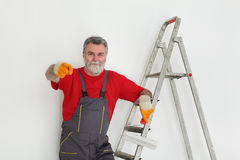 Worker painting  room to white Royalty Free Stock Images