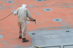 Worker painting ship Royalty Free Stock Images