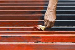 Worker painting steel bars Stock Photos