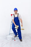 Worker with painting utensils Stock Image