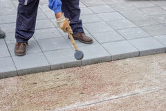 Worker paving new sidewalk 2 Royalty Free Stock Photos