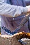 Worker Peeling Logs Outside Stock Image