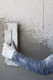 Worker performs internal plaster Stock Photo
