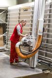 Worker performs work using circular saw for cutting wooden board. Samara, Russia - October 1, 2017: Worker performs work using circular saw for cutting wooden Royalty Free Stock Photography