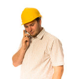 Worker with phone. Man in helmet talking by mobile phone Stock Photo