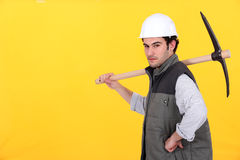 Worker with pick-axe Royalty Free Stock Images