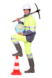 Worker with pickaxe Stock Image