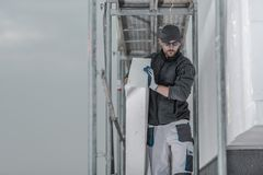 Worker with Piece of Insulation stock images
