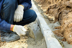Worker placed curbs Stock Photo