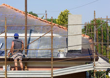 Worker Placing Roof Tiles Royalty Free Stock Images