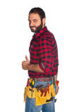 Worker in plaid shirt with thumb up Stock Photography