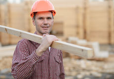 Construction worker with plank Stock Photos