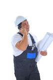 Worker with plans talking on mobile phone Stock Photos