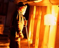 Worker on the plant. Worker near the hot fireplace look to the metal Stock Photography
