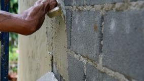Worker plaster the cement wall. In construction site stock footage