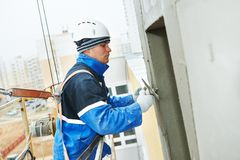 Worker at plastering facade work Stock Photos