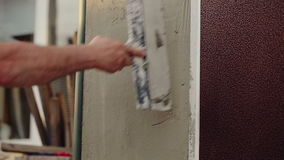 Worker Plastering Wall
