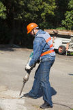 Worker with pneumatic hammer drill equipment. Ready to breaking asphalt at road royalty free stock photography