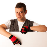 Worker points to blank board Royalty Free Stock Images