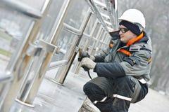 Worker polishing metal fence barrier Stock Images