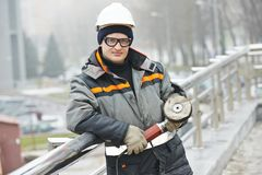 Worker polishing metal fence barrier Stock Photography