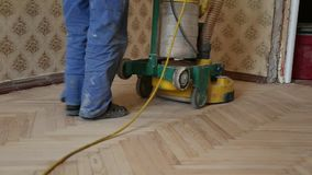 Worker polishing old wooden parquet floor stock footage