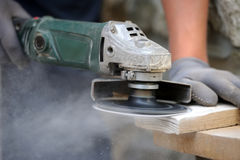 Worker polishing a wood table Royalty Free Stock Image