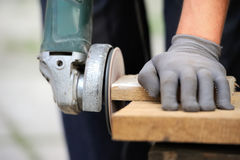 Worker polishing a wood table Stock Image