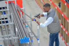 Worker with portable barcode scanner in warehouse. Male Stock Images