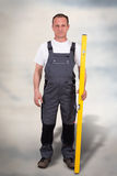 Worker. Portrait of a craftman with spirit level Stock Photo