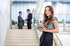 Worker portrait! Woman businessman stands on the stairs looking stock photo