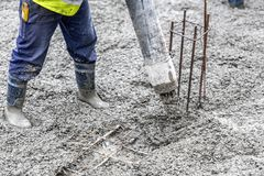 Worker pouring cement and concrete with pump tube. Detail of construction site - worker pouring cement and concrete with pump tube Stock Image