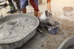 worker pouring cement mix concrete stock photos