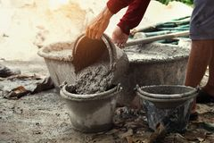 worker pouring cement mix concrete stock photography