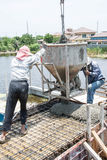 Worker pouring concrete works at construction site. Thailand royalty free stock image