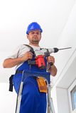 Worker with power drill standing on ladder Royalty Free Stock Photos