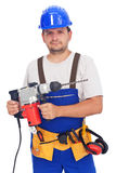 Worker with power tool. Confident worker portrait with power tool and safety equipmant Royalty Free Stock Photography