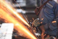 Worker preparation raw materialby hand grinding machine Stock Image