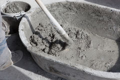 Worker prepare cement mortar ready mixed. Worker prepare ready mixed of cement mortar Royalty Free Stock Photo