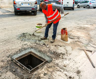 Worker prepares the mortar with a fast setting cement Royalty Free Stock Image