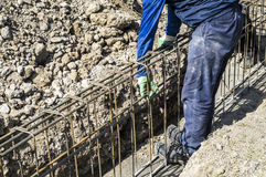 Worker prepares reinforcement for the foundation on the site Royalty Free Stock Photo