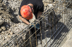 Worker prepares reinforcement for foundations Royalty Free Stock Photo